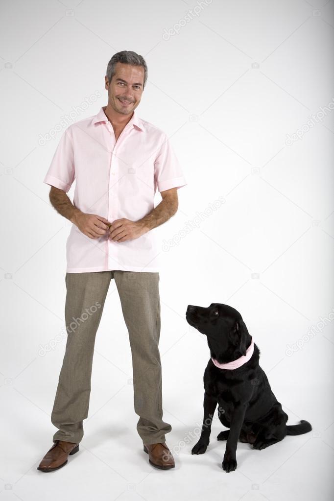 man standing with Labrador dog