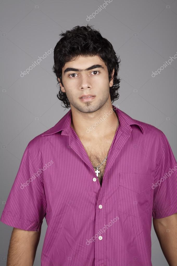 cbbb07b3 Close up studio portrait of young man in purple shirt — Photo by Focusarg