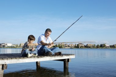 happy father and son fishing