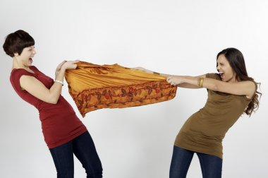 women fighting for clothes