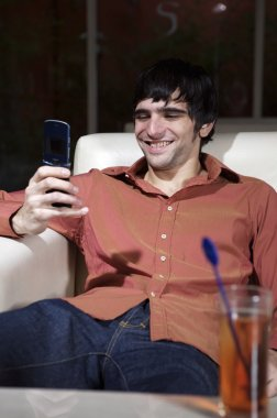 Man sitting with cell phone