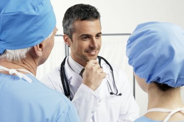 Three doctors discussing something