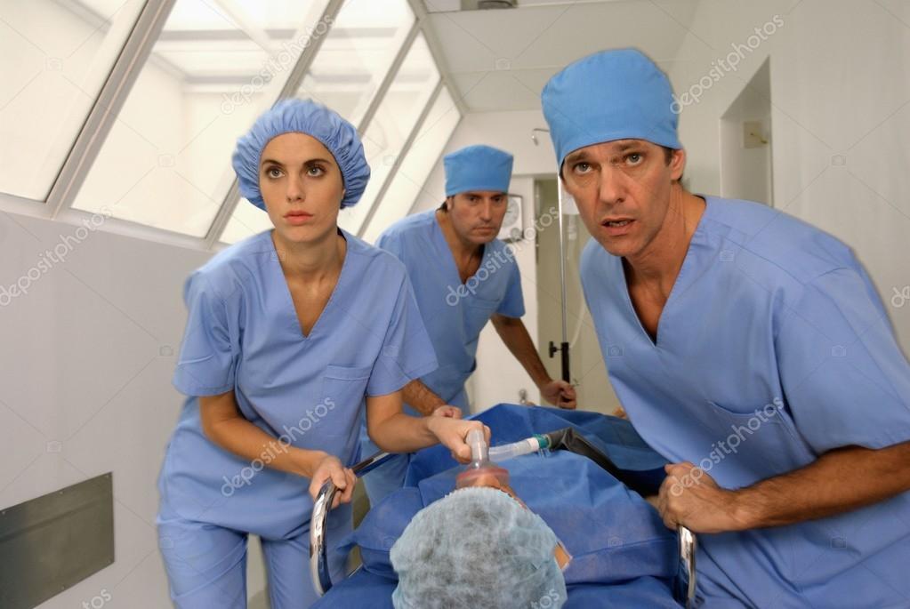 Doctors carrying male patient