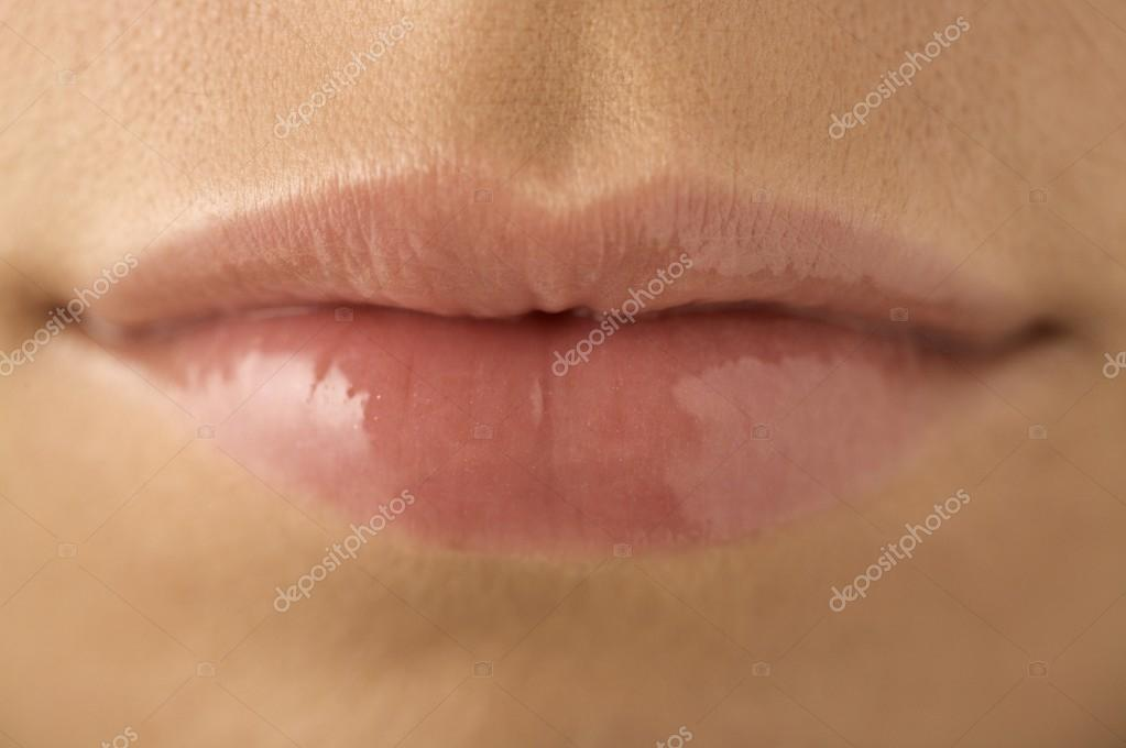 female mouth with clear lipgloss