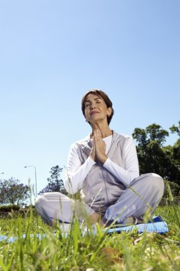 An elderly woman practicing yoga