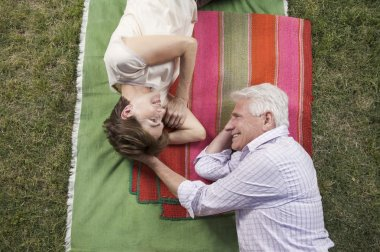 Happy Grandparents on cloth top view