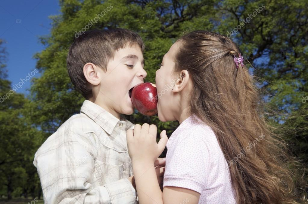 Little boy and girl with red apple