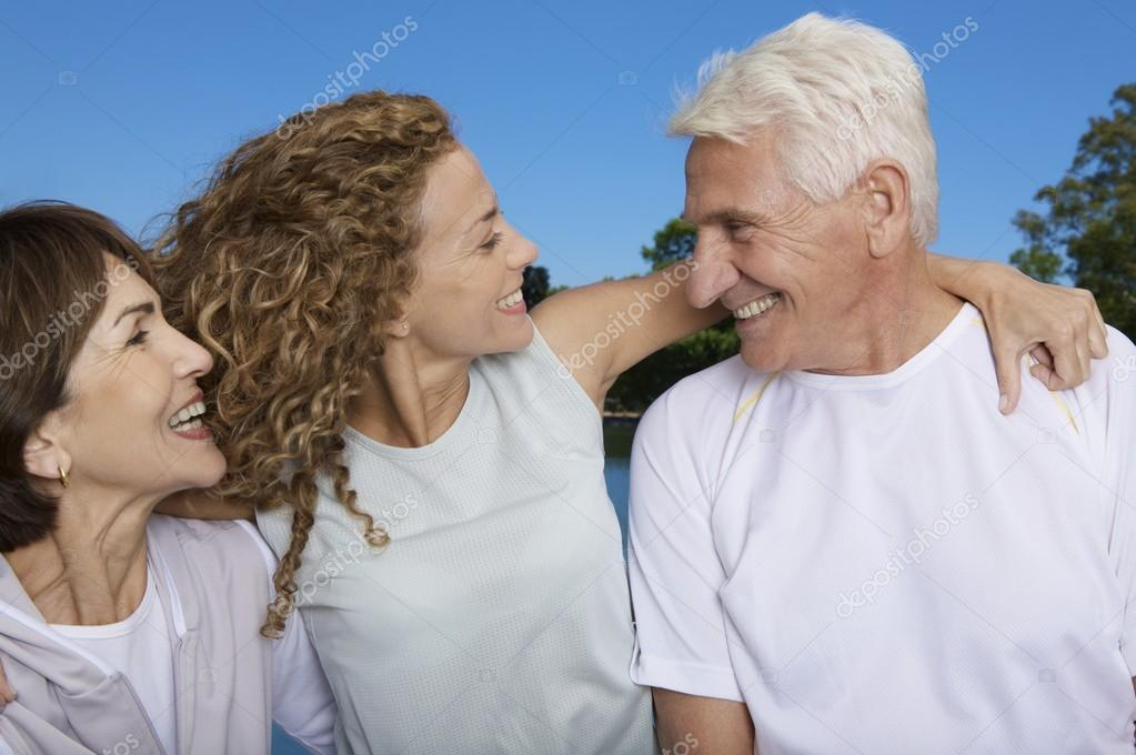 Grandparents  outdoors with daughter
