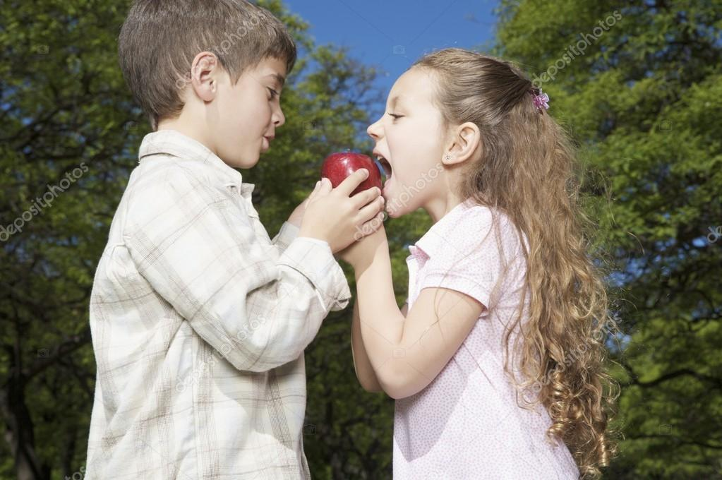 Little boy and girl with apple