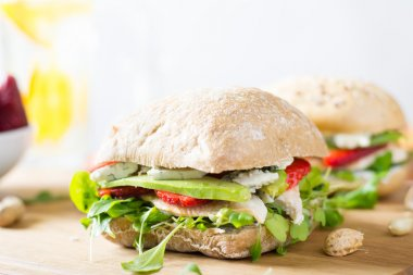 Sandwich with chicken and strawberry