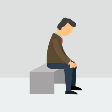 Depressed man sitting on a bench