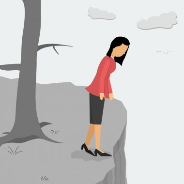 Depressed woman on a cliff looking down
