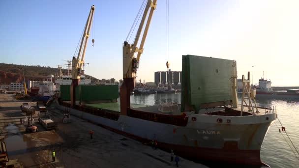 Crane dicharging Laura ship at port of Arzew Algeria March 2016