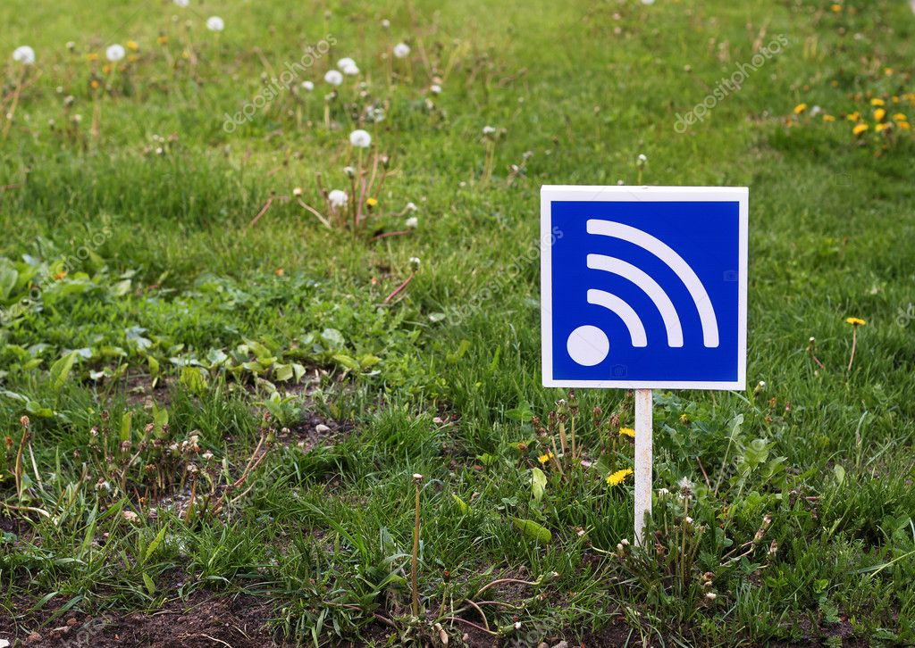 RSS sign on a green lawn. Free wifi simbol. Wi-fi sign.