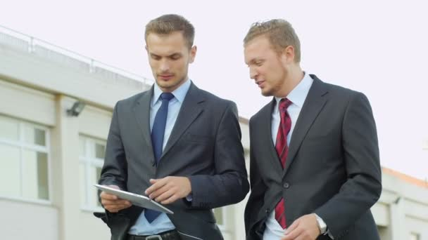 businessmen communicate using tablet