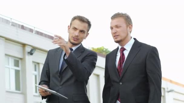 businessmen communicate using tablet