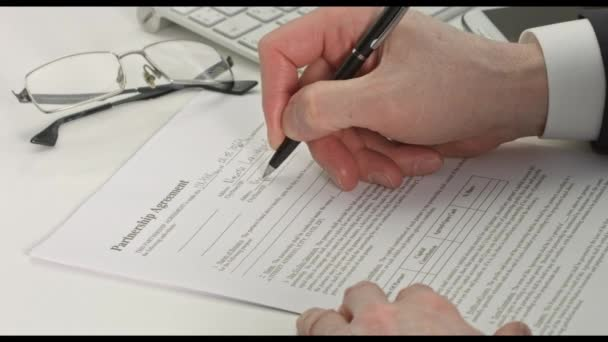 Hand of businessman in suit filling partnership agreement