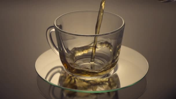 Green Tea being poured into glass tea cup
