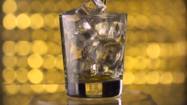 Pouring whiskey into glass