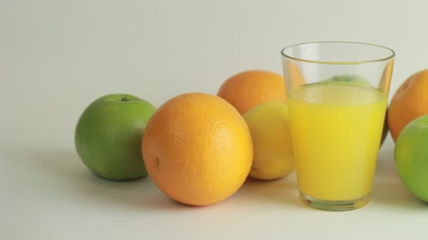 Orange juice and fruits on a white background