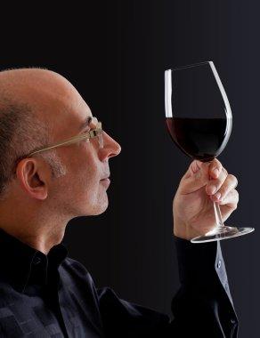 Man observing color in wine