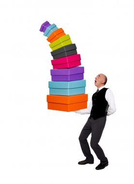 Handsome man holding colorful gift boxes