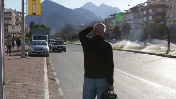 Turkey, Antalya, March 2016: A man waiting for a bus at the bus stop