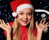Fényképek Christmas little girl in santa hat