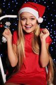 Fényképek karácsonyi lány santa kalap