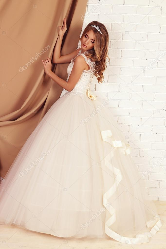 Young bride with blond curly hair