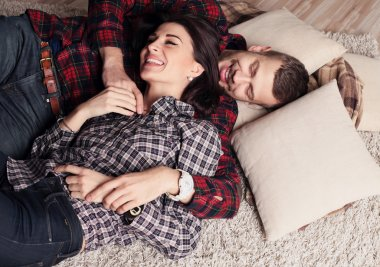 Tender couple relaxing at cozy home