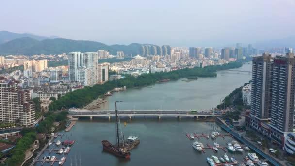 Aerial panorama of river traffic dock at Sanya city, daytime 4k. Hainan island, China