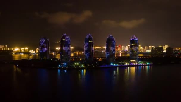 Aerial panorama of illuminated Sanya bay, nighttime, China, time-lapse 4k