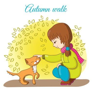 Autumn walk.  Girl and kitten.
