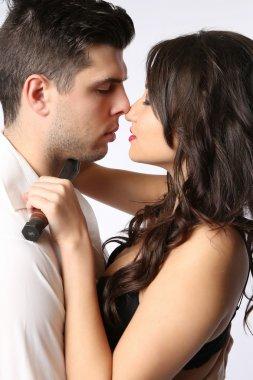Couple in Dangerous Embrace