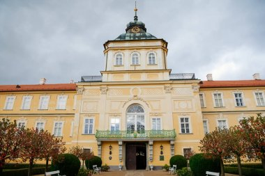 New romantic castle in Horovice, origin of the early Baroque chateau with alley in front of the main entrance in Central Bohemia in autumn day, Czech Republic, October 08, 2017