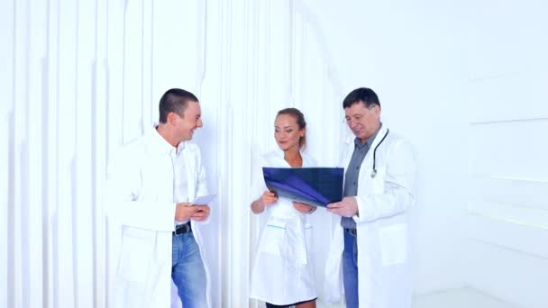doctors team with MRI spinal scan