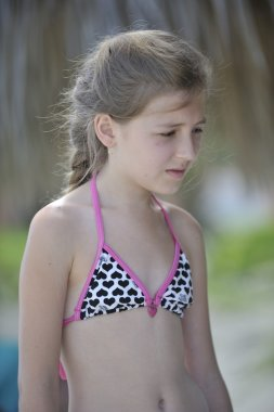 Teenager in swimsuit.
