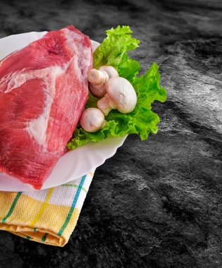Fresh raw meat decorated - raw ham with mushrooms and clipping p