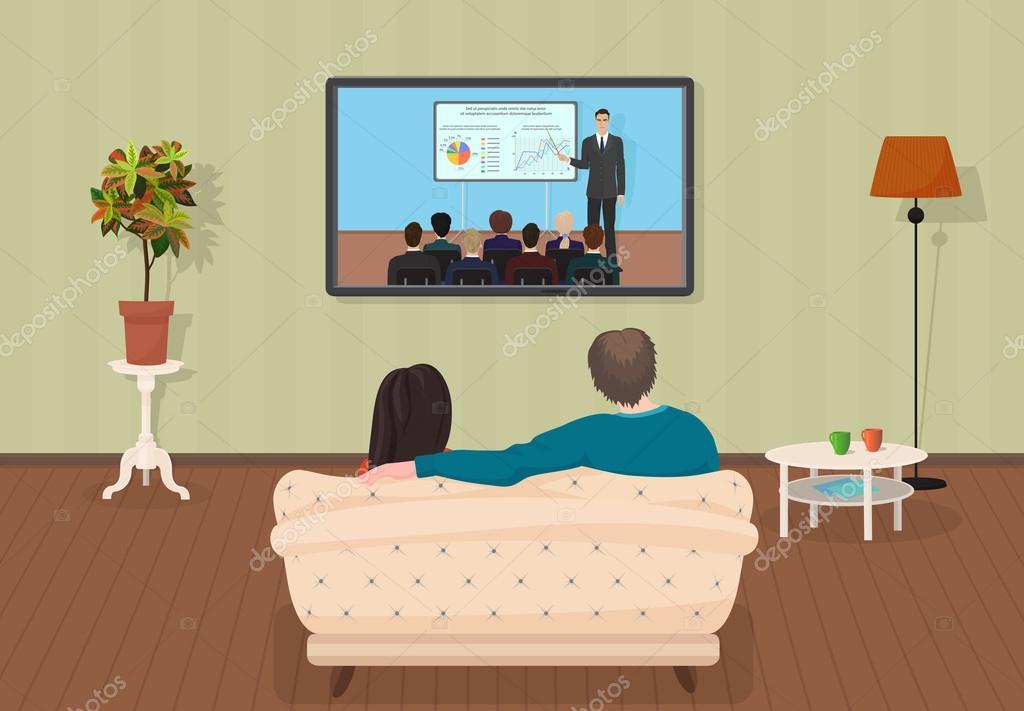 Young family man and women watching TV training tutorial program ...