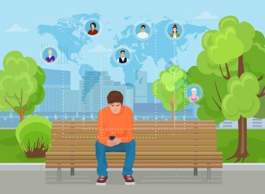 Young guy sitting in the modern city street park and using smartphone phone. Texting to friends in different parts of world.