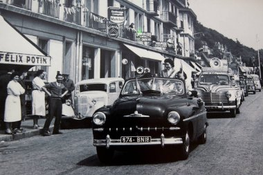 ROUEN, FRANCE - AUGUST Circa, 1944. French car simca vedette during 1950s in street city after the end of the world war two in France. People enjoying life after war. Copy of film photography with noise