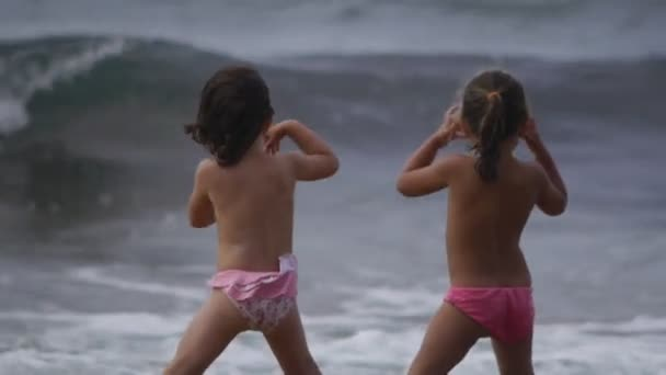 small children looking at the waves