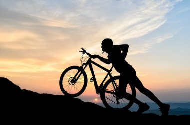 cyclist in the sunset