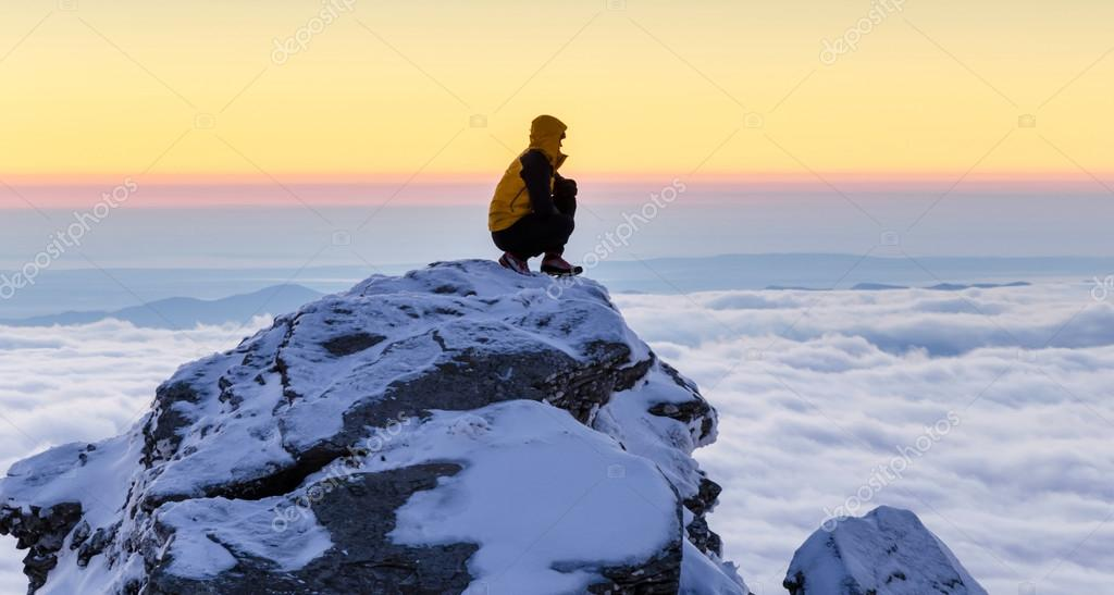 hiker at sunrise on the mountain top
