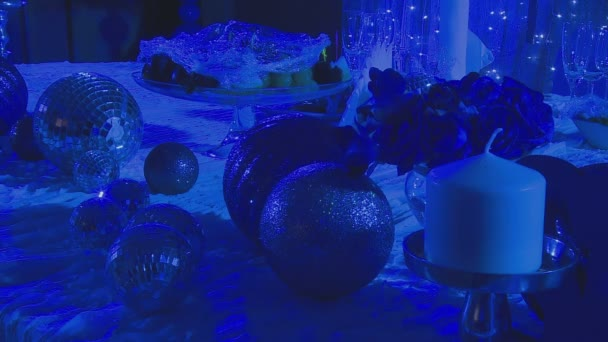 Shiny balls and candles as interior decoration