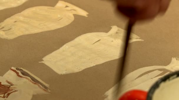 Artist draws pictures of vases, close-up