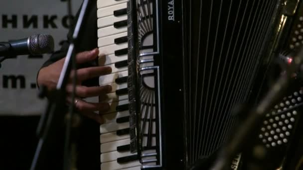 Closeup of man playing accordion