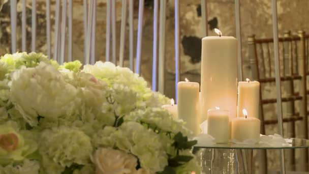 Lighted candles and flowers as decoration interior