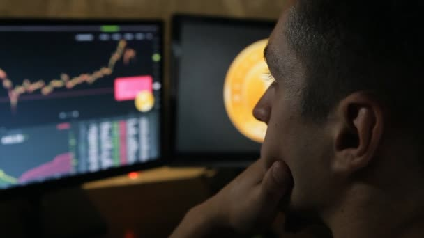 Man works with bitcoins on the financial market on computer